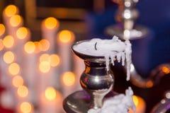 与灼烧的蜡烛的蜡烛台在背景 免版税图库摄影
