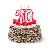 与灼烧的蜡烛第70的蛋糕 免版税图库摄影