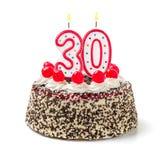 与灼烧的蜡烛第30的蛋糕 库存照片
