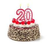与灼烧的蜡烛第20的蛋糕 库存照片