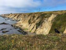与点竞技场灯塔和掠夺的惊人的海岸线 免版税图库摄影