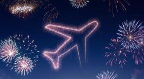 与烟花的夜空塑造了作为飞机 系列 库存图片