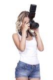 与照相机的妇女射击 库存照片