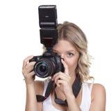 与照相机的妇女射击 免版税库存图片