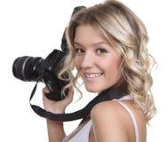 与照相机的妇女射击 免版税库存照片