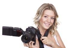 与照相机的妇女射击 库存图片