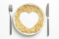 与爱被删去的重点形状的薄煎饼 免版税库存图片
