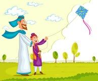 与父母的回教男孩飞行风筝 图库摄影