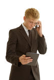与片剂和移动电话的商人 库存图片
