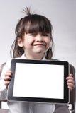与片剂的孩子 免版税库存照片
