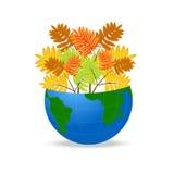 与狂放的灰秋叶的行星地球  免版税图库摄影