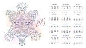 与狗狗被仿造的头的日历  库存图片