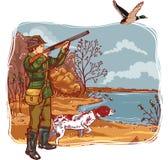 与狗的猎人 免版税图库摄影