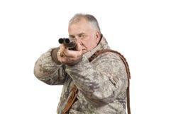 与猎枪的猎人 免版税库存图片
