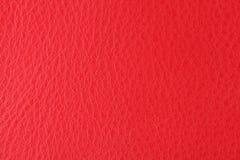 与猩红色皮革纹理的背景  免版税库存图片