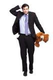 与玩具熊的没有金钱商人 库存图片