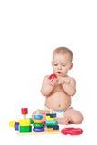 与玩具的小的儿童游戏在空白背景 免版税库存照片