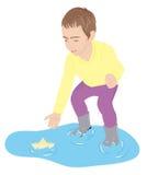 与玩具纸船的儿童游戏 图库摄影