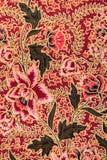 与玫瑰的蜡染布模式 免版税库存图片