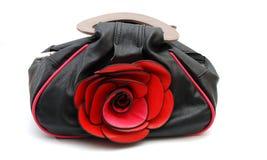 与玫瑰色花的妇女手袋 库存照片
