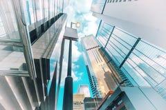 与现代摩天大楼的未来派都市风景视图 香港 免版税库存照片