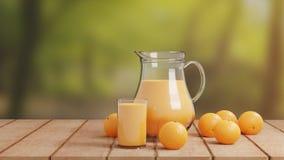 与玻璃和投手的橙汁过去在木地板上 免版税库存图片