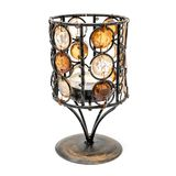 与玻璃小平面的古色古香的金属蜡烛台 库存图片