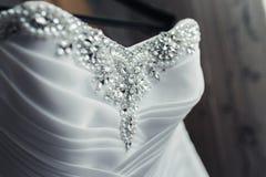 与珍珠的婚礼礼服 免版税图库摄影