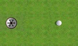 与球接近的高尔夫球孔 免版税图库摄影