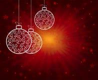 与球的红色圣诞节背景 库存照片