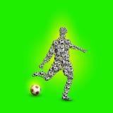 与球的足球运动员剪影 免版税库存图片