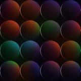 与球的黑暗的与彩虹颜色的背景或圈子 免版税库存图片
