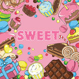 与甜点的无缝的背景 免版税图库摄影