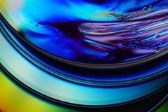 与生动的色谱的DVD 宏观抽象五颜六色的backgroun 库存图片