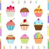 与生日快乐蜡烛的逗人喜爱的杯形蛋糕 免版税库存图片