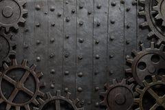 与生锈的齿轮和嵌齿轮的老金属背景 图库摄影