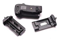 与电池盘子的一个数字式单镜头反光照相机垂直的夹子 免版税库存图片