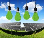 与电灯泡的太阳能盘区 免版税图库摄影