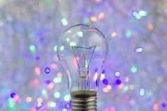与电灯泡的抽象圆bokeh背景 库存照片