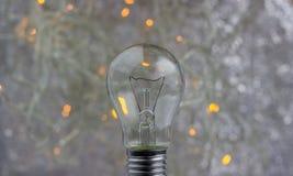 与电灯泡的抽象圆bokeh背景 库存图片