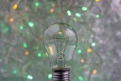 与电灯泡的抽象圆bokeh背景 免版税库存照片