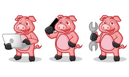 与电话的深桃红色的猪吉祥人 库存照片