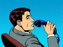与电话的生意人 免版税库存照片