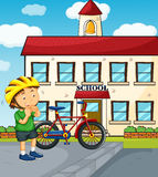 与男孩和自行车的学校场面 库存图片