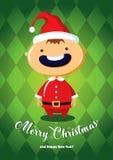 与男孩的圣诞卡圣诞老人服装的 免版税库存图片
