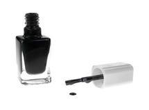 与画笔水滴的黑色指甲油 库存照片