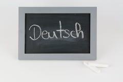 与白垩的黑板德语 免版税图库摄影