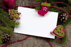 与白皮书和雪的圣诞节背景 免版税库存图片