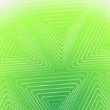与白色三角的抽象绿色背景 库存照片