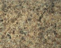 与白色和黑注入的浅褐色的花岗岩 库存图片